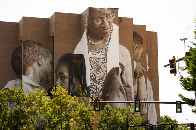A mural depicting Pearlie Harris is visible at the eight-story Canvas Tower in downtown Greenville Wednesday, Aug. 26, 2020.