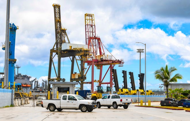 A Port Authority of Guam vehicle approaches a security checkpoint at the Jose D. Leon Guerrero Commercial Port facility in Piti in this Aug. 26 file photo.