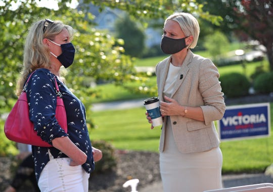 Republican candidate for Indiana's 5th Congressional District Victoria Spartz, right, talks with Emergency Medicine Physician Tonya Hole at a fundraiser coffee in Carmel, Tuesday, Aug. 25, 2020.
