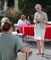 Republican candidate for Indiana's 5th Congressional District Victoria Spartz, right, talks with women at a fundraiser coffee in Carmel, Tuesday, Aug. 25, 2020. She removed her  mask when the people at the outdoor fundraiser were socially distanced.