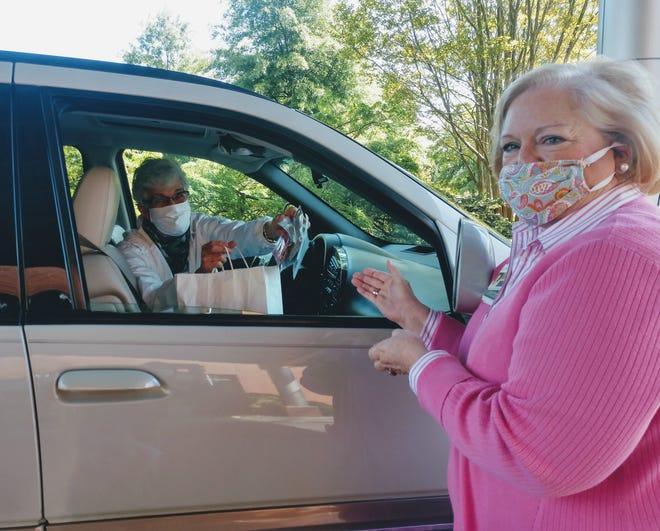 A Tennova volunteer donates handmade masks during the pandemic.