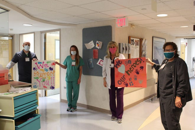 Covenant Health's Fort Sanders Regional day surgery team receives signs of encouragement during the pandemic.