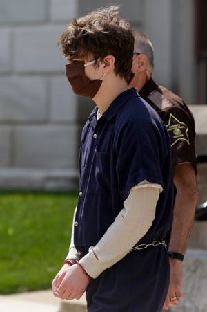 Talmadge Russell Jasper is lead out the Tippecanoe County Courthouse by sheriff's deputies after pleading guilty in connection with May 2019 killing of Ryan A. Martin, Wednesday, Aug. 26, 2020 in Lafayette.