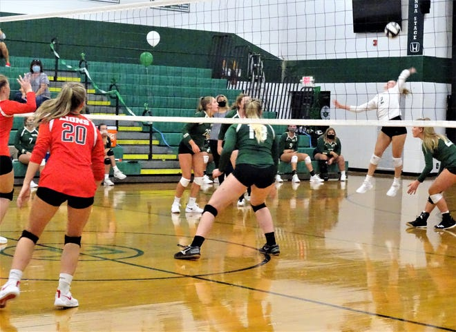 Fisher Catholic senior Haylee Cordle prepares to hit the ball back to Liberty Union during their game Tuesday night at Fisher Catholic. The Lions won 3-0.