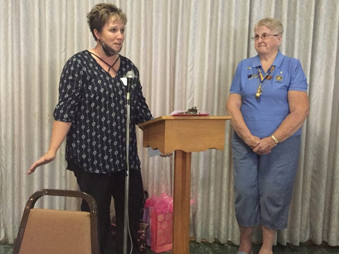 Lindsay Roberts, left, thanks the Mansfield Civitan Club as president Sandy Stout looks on Tuesday.