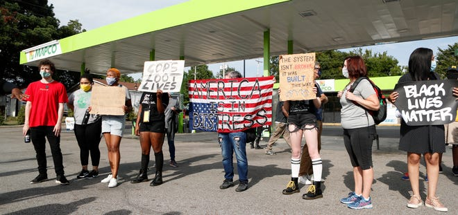 Protesters gather at the Mapco on Elvis Presley Boulevard in Memphis, Tenn., on Wednesday, Aug. 26, 2020, in response to the shooting of a 17-year-old man by a law enforcement officer on Tuesday.
