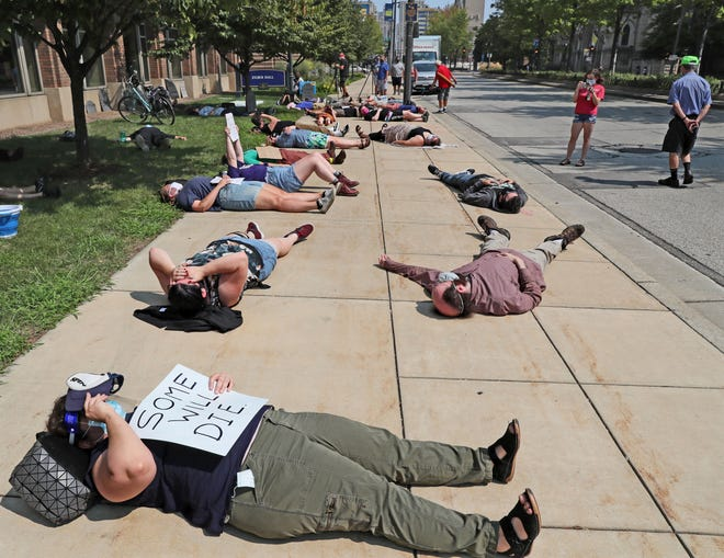 Members of the Marquette Academic Workers Union, which has yet to be recognized by Marquette University, staged a die-in outside Zilber Hall to protest lack of COVID-19 protections and no health insurance. Made up of graduate assistants and other academic type workers, union members do not feel their health is being adequately protected in the reopening plan.