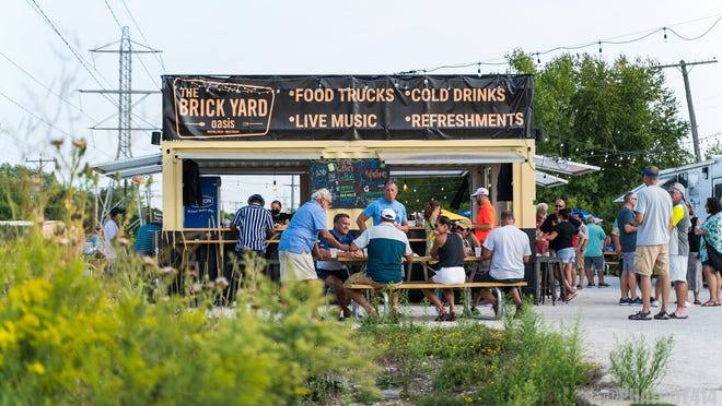 The Brick Pub and Grill has partnered with Containers Up to open The Brick Yard Oasis in a former parking lot at 4429 W. River Lane.