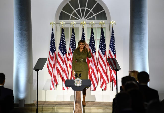 First lady Melania Trump waves from the Rose Garden of the White House as she addresses the Republican National Convention during its second day.
