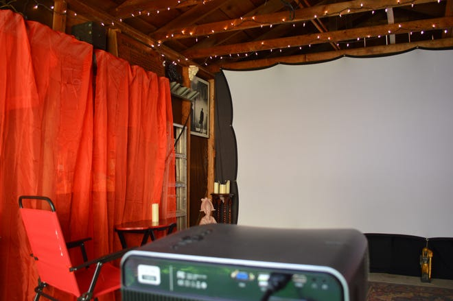 Franz Buchholtz and Catherine Jozwik, who live on the St. Francis/Milwaukee border, have set up a 150-inch screen, projector and sound system in their garage to create a movie theater for family and friends.