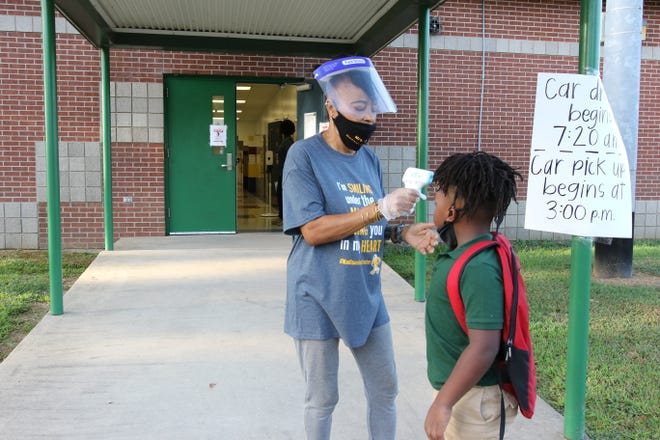 Teachers at Madison James Foster Elementary in Monroe welcomed students to the first day of class on Aug. 26 with precautions in place to reduce the spread of COVID-19.
