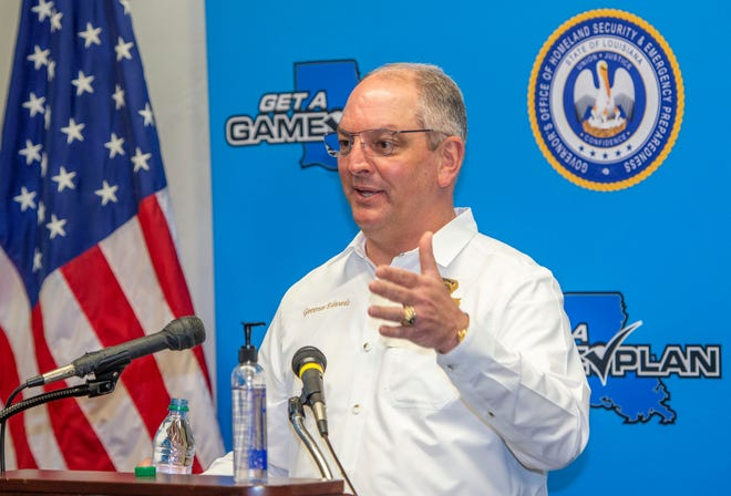 Louisiana Gov. John Bel Edwards answers questions Monday August 24, 2020 while holding a media briefing about the state's activity related to Hurricanes Marco and Laura, in addition to hosting a Unified Command Group meeting afterwards. Both storms are forecast to impact Louisiana this week within a few days of each other, in Baton Rouge, La.   (Bill Feig./The Advocate via AP)