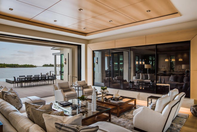 A custom estate at 700 Admiralty Parade West provides homebuyers a preview of the design possibilities created by Romanza Interior Design.