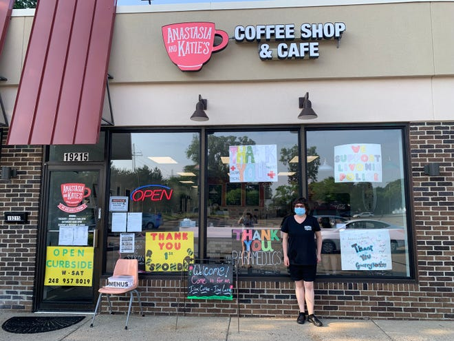 Marissa Marzec stands outside Anastasia and Katie's Coffee Shop & Cafe.