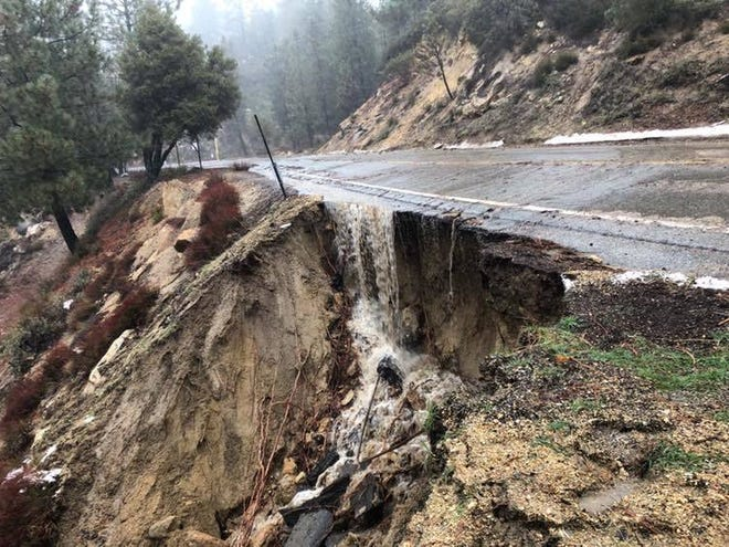 """A portion of Highway 243 near Saunders Meadow eroded as an """"atmospheric river"""" storm continued to pummel Southern California on Feb. 14, 2019."""