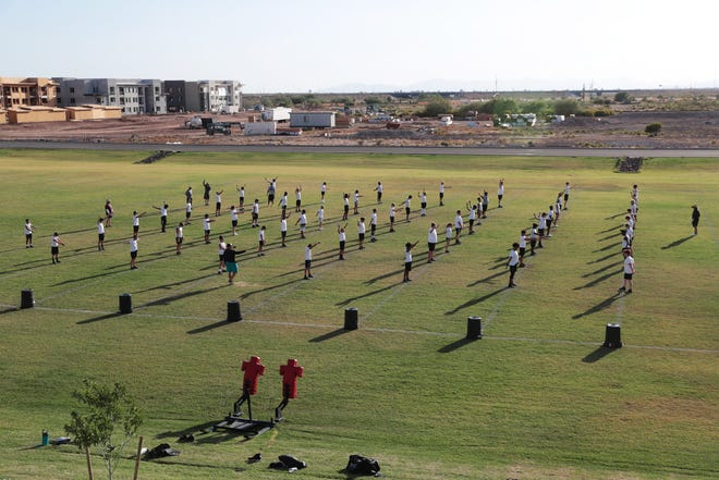 Eastmark High football players perform drills during practice in Mesa July 13, 2020. The school in the Queen Creek Unified School District is entering it's second year.