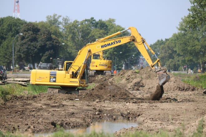 The $1.4 million wetlands restoration project between Waterworks Park and the city beach in Port Clinton is now back underway.