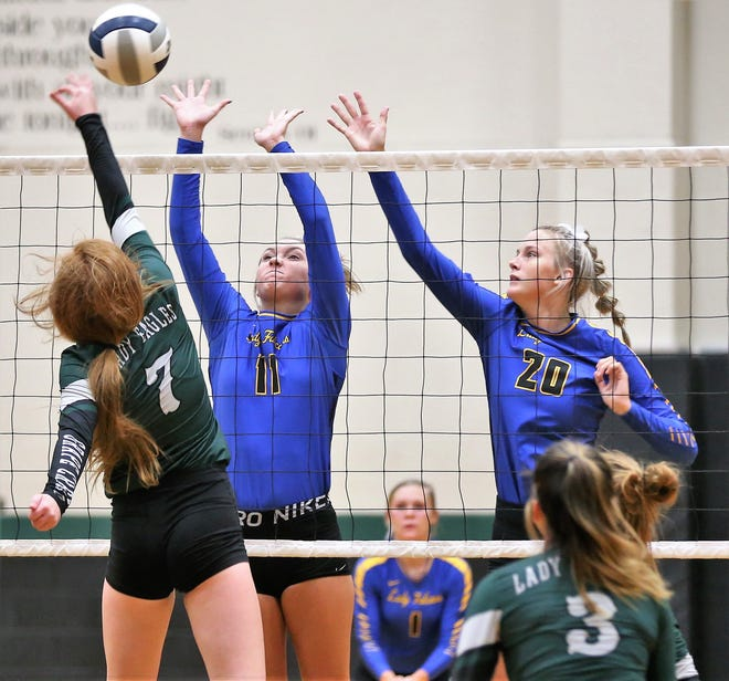Veribest's Cora Blackwell, center, and Bella Halfmann try to block a shot by Grape Creek's Ivy Lane during a volleyball match at Grape Creek High School on Tuesday, Aug. 25, 2020. Veribest won 30-28, 25-22, 29-31, 25-19 in the season opener for the Lady Falcons.