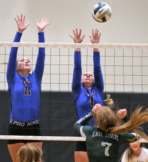 Veribest's Cora Blackwell, 11, and Kennadi Wheeless go up for a block on a shot by Grape Creek's Ivy Lane during a volleyball match at Grape Creek High School on Tuesday, Aug. 25, 2020.