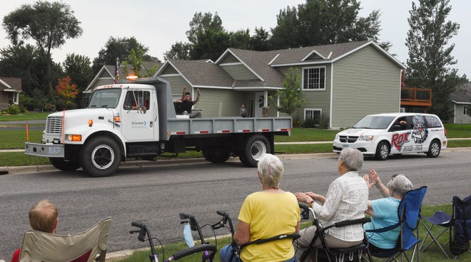 """St. Cloud resident James Calacsan sings at the Realife Cooperative senior living community at the beginning of the """"parades on demand"""" route Wednesday, Aug. 26, 2020, in St. Cloud."""
