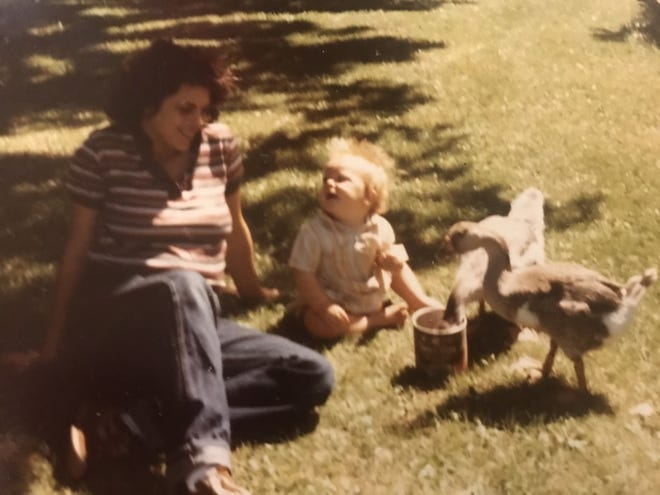 Editor Colleen Kottke and her son, Ben, spend time with their young geese Happy and Jolly.