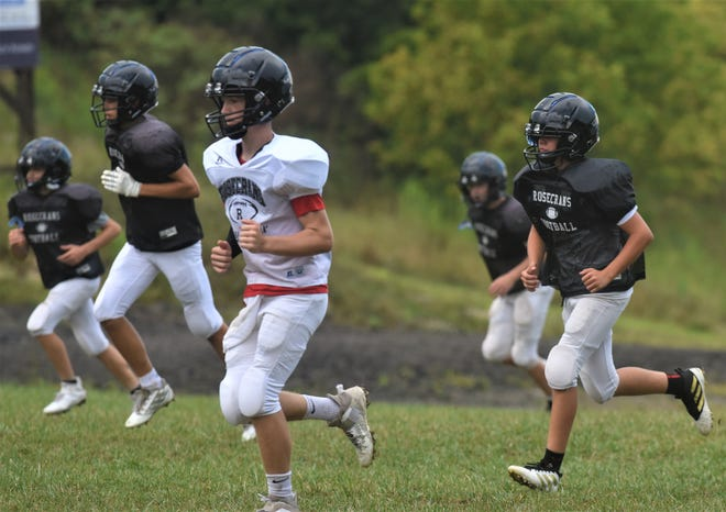 Rosecrans players run through conditioning drills during Tuesday's practice. The Bishops have 17 players and will return to 11-man football after one season of playing 8-man.