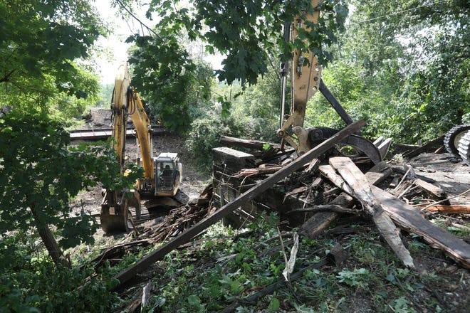 The Liberty Road bridge in New Concord was demolished on Tuesday. The bridge was closed to vehicular traffic in 2014. The village is working with the Ohio Central Railroad on a potential new grade crossing to ease access to the village. According to a release from the village, the bridge was removed to allow higher railroad cars to pass under.