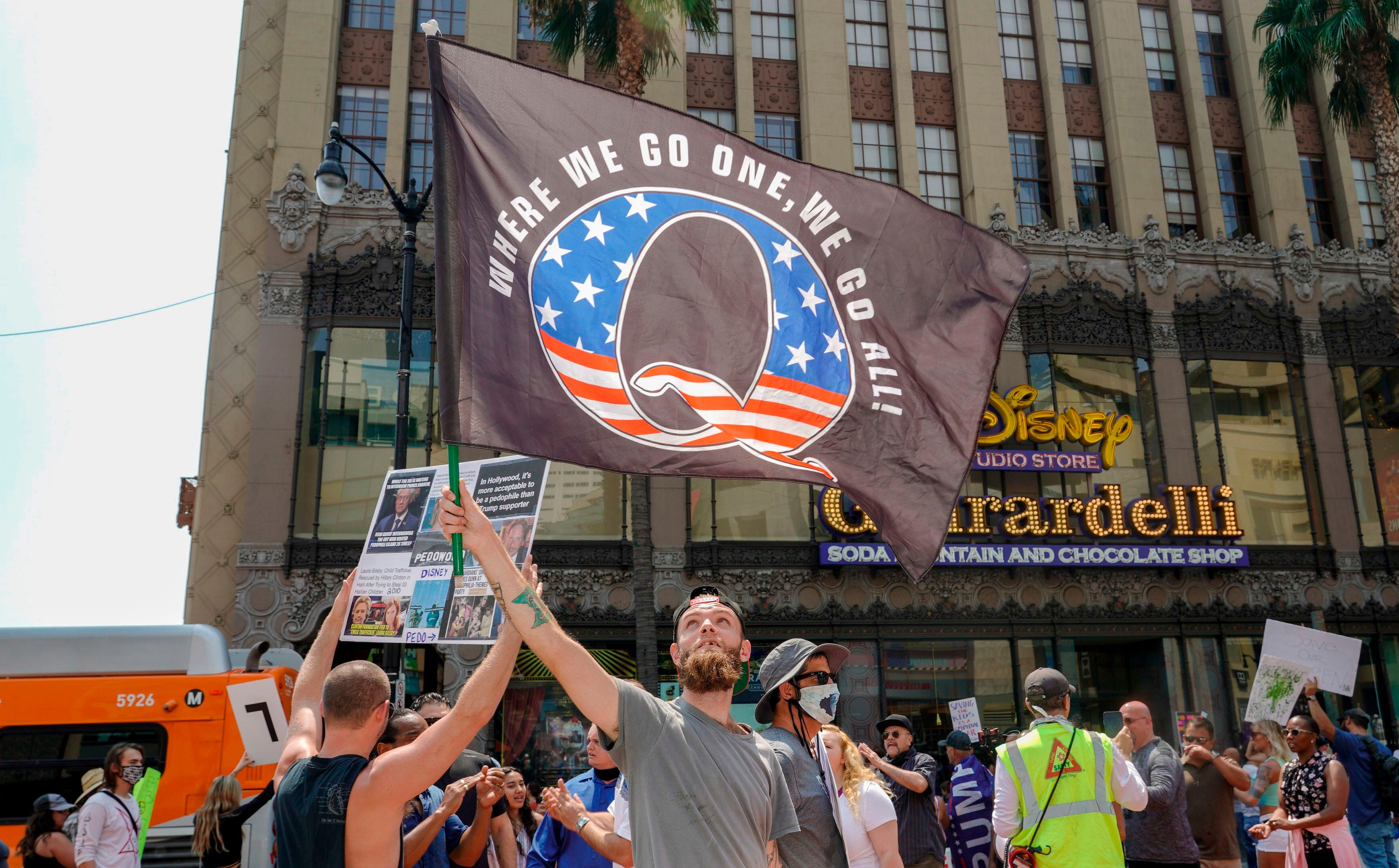 QAnon demonstrators protest on Hollywood Boulevard in Los Angeles Aug. 22.  A 2019 bulletin from the FBI warned that conspiracy-theory-driven extremists are a domestic terrorism threat.