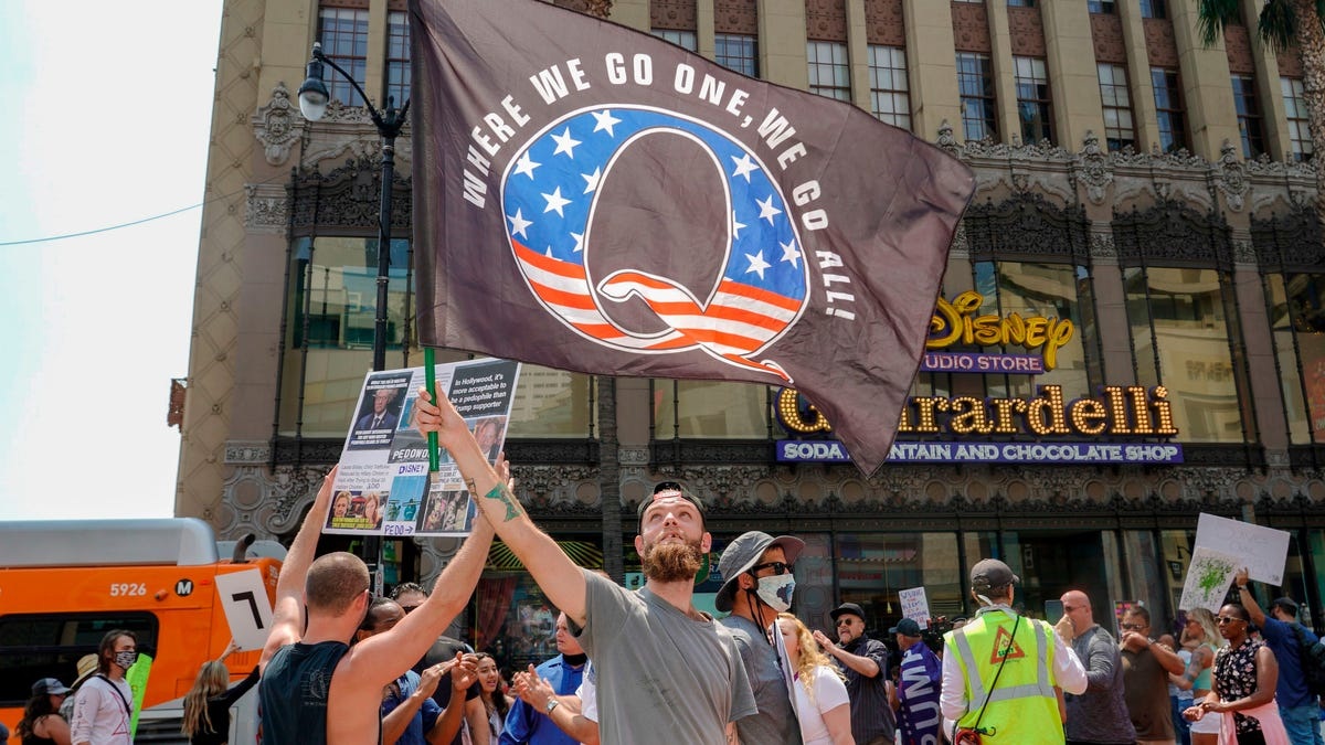 How QAnon and other dark forces are radicalizing Americans as the COVID-19 pandemic rages and election looms