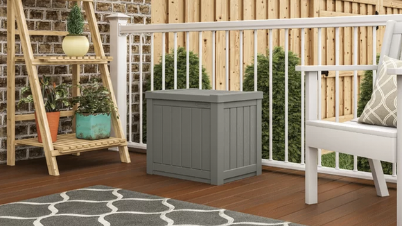 Neutral, unobtrusive, and sturdy enough to use as a side table, this storage bin is a great way to make the most of limited space