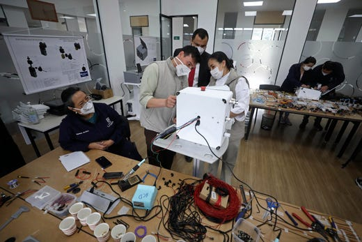 Engineering faculty and workers at La Sabana University work on a low-cost ventilator for patients with COVID-19 in Bogota, Colombia, Monday, July 6, 2020.