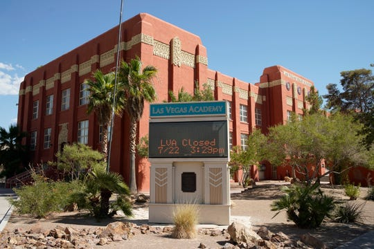 A sign announces that the Las Vegas Academy is closed on July 22 in Las Vegas. Clark County school trustees cited fears of spreading the coronavirus and unanimously decided to begin the 2020-2021 school year using distance education.