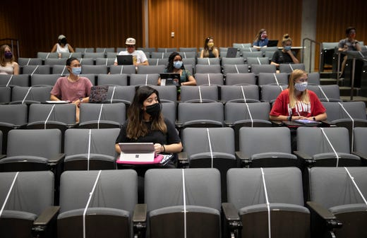Karina Patino, front, attends a Criminology class at the Gates Dell Complex at UT on Wednesday Aug. 26, 2020. Students returned to the UT campus on Wednesday for limited in-person classes for the first time since the the university moved to remote instruction in March.