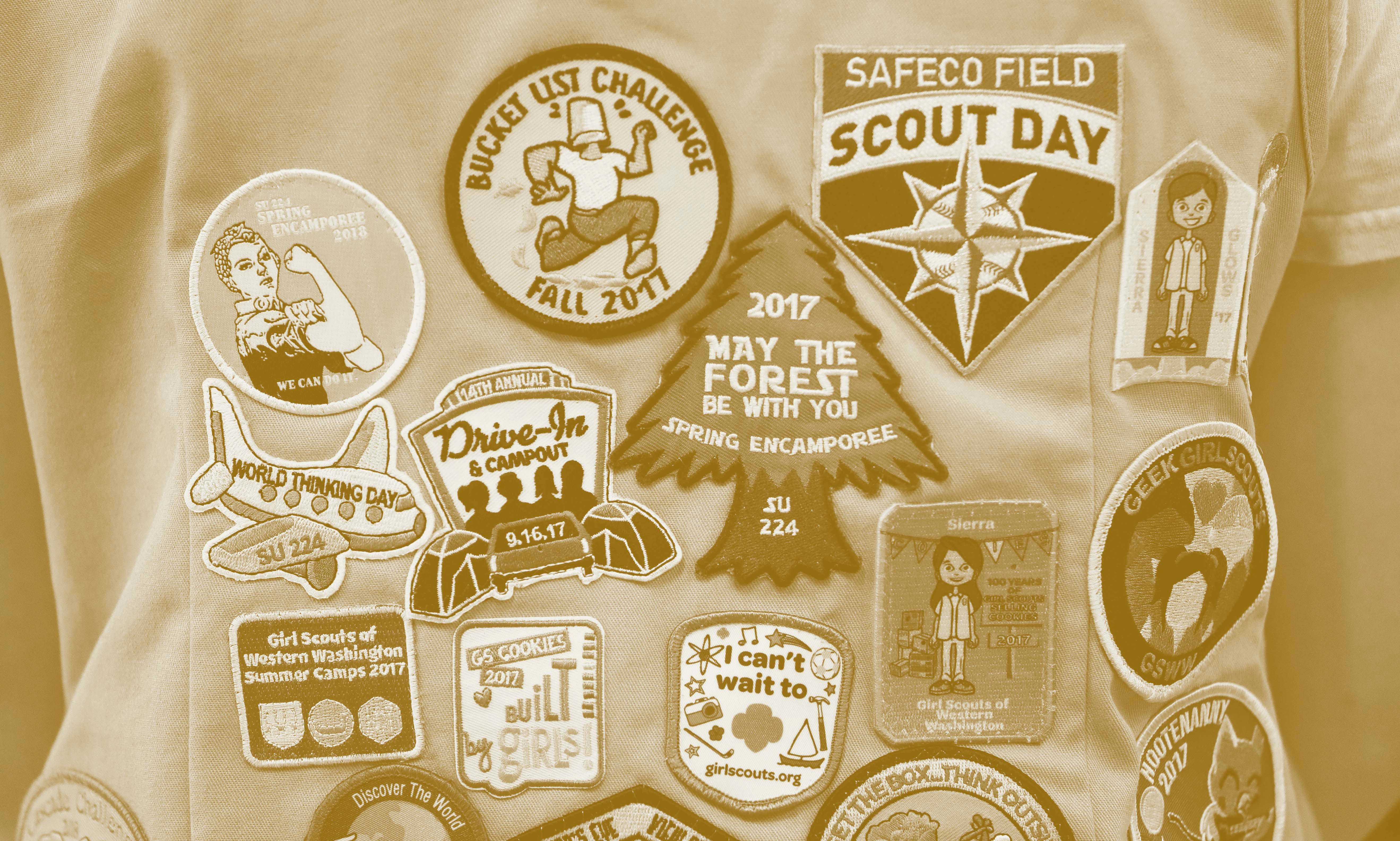 Patches cover the back of a Girl Scout's vest in Seattle in 2018.
