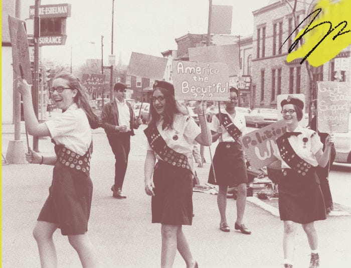 Girl Scout Cadettes picket for environmental cleanup in 1970.