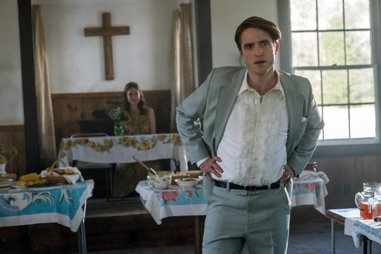 """Robert Pattinson stars as an unholy reverend in an Ohio town full of shady and sinister characters in the psychological thriller """"The Devil All the Time."""""""