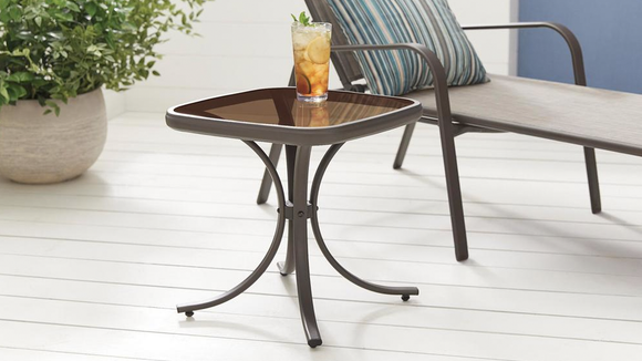 This steel and glass table will survive wind and rain, and look good doing it