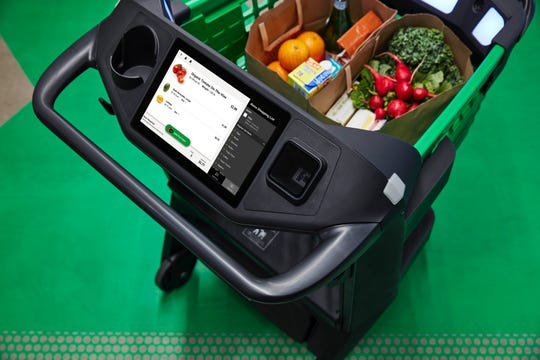 Amazon's Dash Cart lets customers at its new Fresh supermarket check out directly from the cart