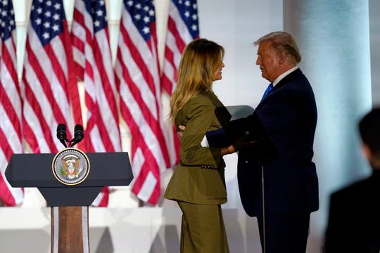 President Donald Trump joins first lady Melania Trump on stage after her speech to the 2020 Republican National Convention from the Rose Garden of the White House, Tuesday, Aug. 25, 2020, in Washington.