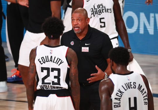 Los Angeles Clippers coach Doc Rivers talks with Lou Williams during the first half of Game 5 against the Dallas Mavericks.