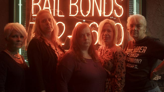 Ellen, far left, Sandi, Tracy and Sabrina Dunlap were hoodwinked by Richard Scott Smith. They are photographed with bounty hunter Carla Campbell, far right.