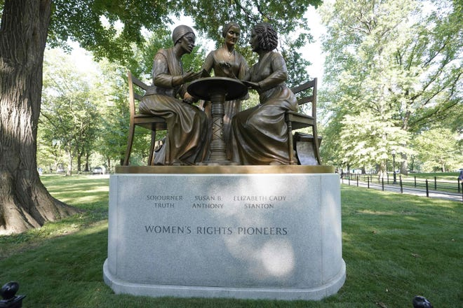 The unveiling of the statue of women's rights pioneers Susan B. Anthony, Elizabeth Cady Stanton and Sojourner Truth is seen in Central Park in New York on August 26, 2020, marking the park's first statue of real-life women.