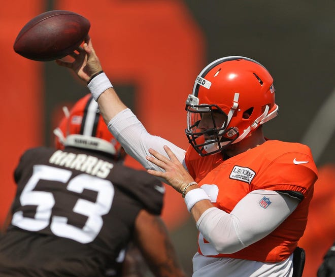Browns quarterback Baker Mayfield makes a pass during practice Thursday.