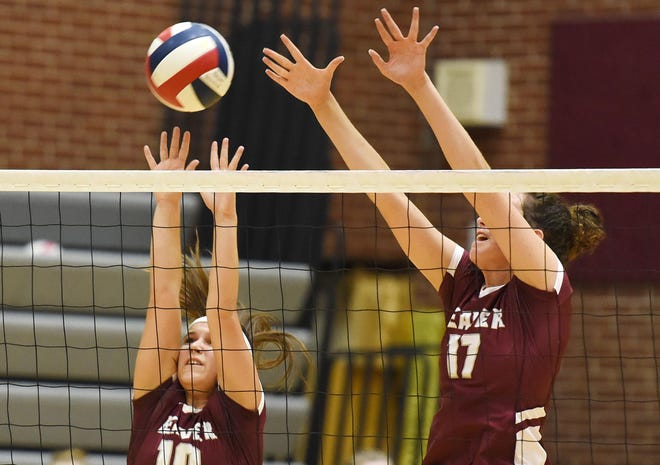 Beaver's Talia Gallagher (10) and Kylie Haczela (17) block a shot against Neshannock last season. Beaver is one of several volleyball teams playing in a new classification or section this season.