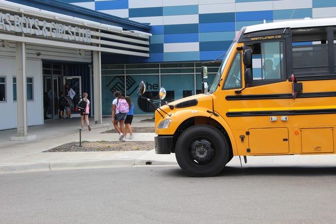 School students arrive Thursday at the Boys & Girls Club of Bartlesville. Kim Archer/Examiner-Enterprise