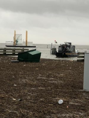 A Terrebonne Parish Sheriff's Office Water Patrol boat in Pointe-aux-Chenes approaches debris from Hurricane Laura as cleanup beings.