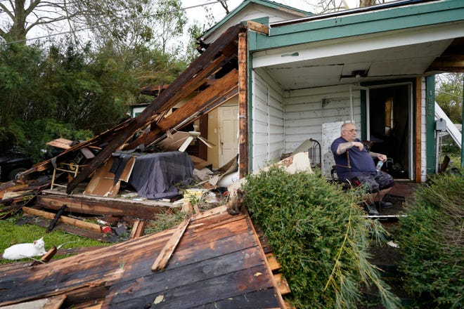 Chris Johnson views destruction at his home in Lake Charles after Hurricane Laura moved through the state. Johnson stayed in his home as the storm passed.