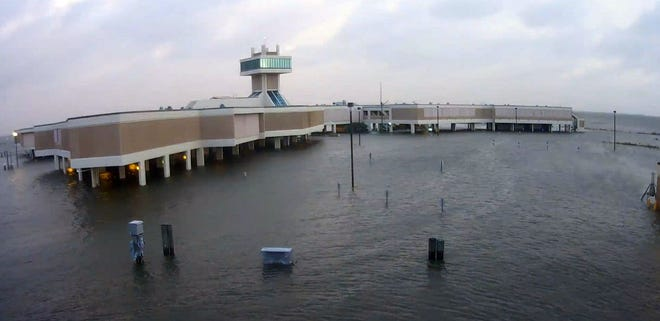 Floodwaters from Hurricane Laura flow under LUMCON's marine research center in Cocodrie. Some parts of the building, those at ground level, saw as much of 2 1/2 feet of floodwater inside, center officials said on Facebook.