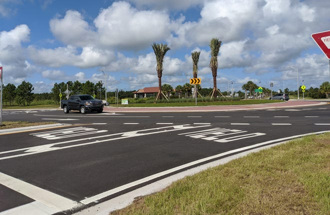 Palm Coast city officials will distribute a survey in January to better understand residents' concerns. One point of contention included asking residents to pay for road repairs.
