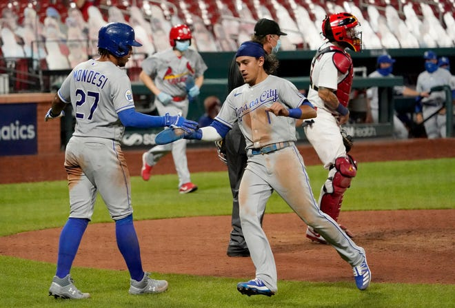 Kansas City Royals' Nicky Lopez (1) and Adalberto Mondesi (27) celebrate after scoring on a double by Whit Merrifield during the ninth inning of Wednesday's game against the St. Louis Cardinals at Busch Stadium. That gave the Royals a 5-2 lead but the Cardinals rallied for four runs in the bottom of the ninth to claim a 6-5 win.
